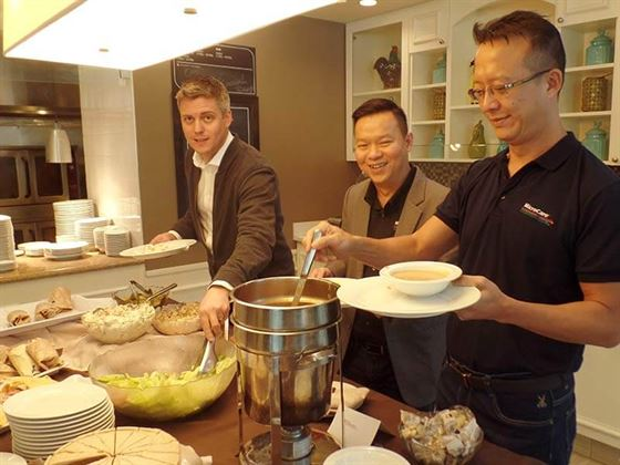 "A sales team is like an army, and as Napoleon said, ""it runs on it's stomach."" At the MicroCare global sales meeting, keeping everybody fed is a top priority. Here Liam Taylor, Jerald Chan and Joe Ng enjoy the lunch break."