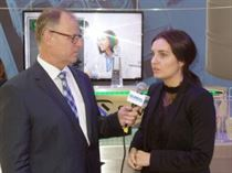 Miriam (right) made a wonderful presentation in German to a broadcaster at the expo