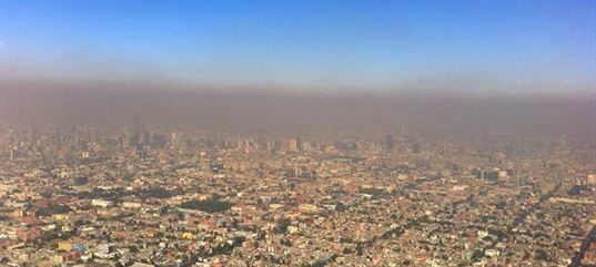 The burning of organic materials, such as gasoline or coal, produces smog over cities around the world. While solvents are a tiny part of this very big problem, the use of low VOC solvents makes a difference. Photo: smog over Mexico City.